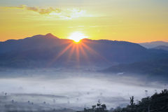 Sun rise on mountains Stock Photography