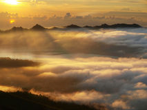Sun rise over batur lake Stock Photos