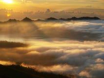 Sun rise over batur lake Stock Photos