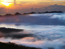 Sun rise over batur lake Stock Images