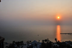 Sun rise Over the Beach Cha-Am. Sun rise Over the Beach Cha-Am in Thailand on the building of luxury. Then came the wake refreshed. The first light of a new day Royalty Free Stock Photography