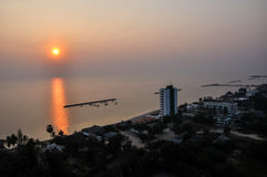 Sun rise Over the Beach Cha-Am. Sun rise Over the Beach Cha-Am in Thailand on the building of luxury. Then came the wake refreshed. The first light of a new day Stock Image