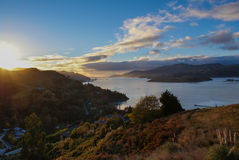 Sun rise over Governors Bay, New Zealand. The morning sun rising over Governors Bay in New Zealand Stock Photos