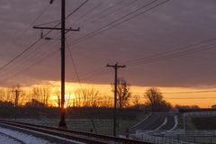 Sun rise over railway track and a farm royalty free stock images
