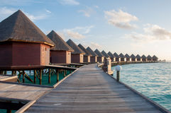The sun rise over water bungalows in amazing water villas Royalty Free Stock Photography