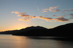 Sun rise at Queen Charlotte Sound. Queen Charlotte Sound is the easternmost of the main sounds of the Marlborough Sounds, in New Zealand's South Island Royalty Free Stock Image