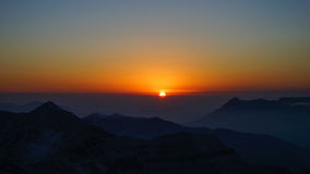 Sun rise. Record sun rise on the top of a mountain Stock Photography