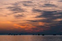 Sun rise at rock sea beach. Golden reflection on beach sand after wave crash Stock Image