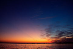 Sun rise at rock sea beach Stock Image