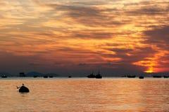 Sun rise at rock sea beach Stock Images
