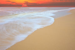 Sun rise at sea beach show movement of sea wave Stock Image