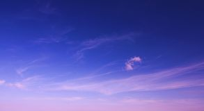 Sun rise sky with clouds. Sun rice blue purple sky with clouds Royalty Free Stock Image