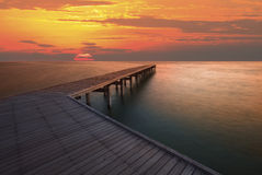 Sun rise sky and old wood bridge pier Royalty Free Stock Photo