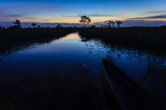 Sun rises as dawn breaks on the marsh, Botswana, Africa Stock Photography