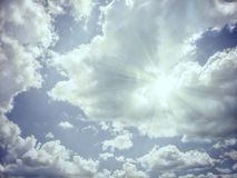 The sun rises behind the clouds Stock Photography