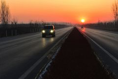 The sun rises at the end of the stretch of the road Royalty Free Stock Images