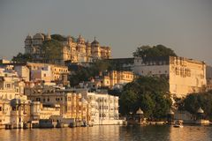 Sun rises on the Ghats of Udaipur. The Sun rises on the Ghats on the shore of Lake Pichola in Udaipur, India stock image