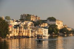 Sun rises on the Ghats of Udaipur royalty free stock photo