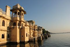 Sun rises on the Ghats of Udaipur. The Sun rises on the Ghats on the shore of Lake Pichola in Udaipur, India stock photography