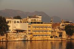 Sun rises on the Ghats of Udaipur. The Sun rises on the Ghats on the shore of Lake Pichola in Udaipur, India stock photos