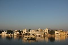 Sun rises on the Ghats of Udaipur. The Sun rises on the Ghats on the shore of Lake Pichola in Udaipur, India royalty free stock photography