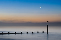 Sunrise Greets The Moon Royalty Free Stock Image