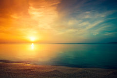 The sun rises over a calm sea Stock Photography