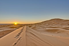 Sun rises over Erg Chebbi at Morocco Royalty Free Stock Image
