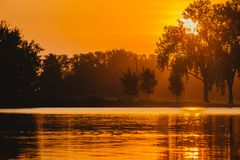 The Sun Rises over Gray`s Lake in Des Moines, Iowa stock images