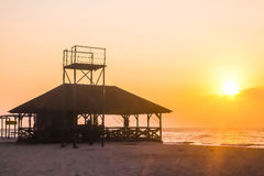 The sun rises over the house by the sea Stock Images