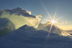 Sun rises over the ice floes. Royalty Free Stock Photography