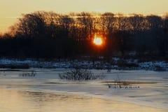 The sun rises over the lake Stock Photo
