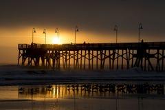 Sunrise over a fishing Pier. The Sun rises over the Main Street Pier in Daytona Beach, FL February 8, 2017 Stock Photo
