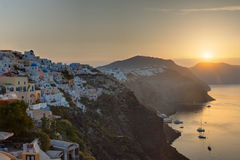 The sun rises over Oia Stock Photo