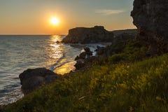 Sun rises over the Sea of Azov on Generals beach. Karalar regional landscape park in Crimea. Stock Photo