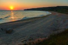 Sun rises over the Sea of Azov on Generals beach. Karalar regional landscape park in Crimea. Stock Photos
