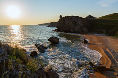 Sun rises over the Sea of Azov on Generals beach. Karalar regional landscape park in Crimea. Royalty Free Stock Images