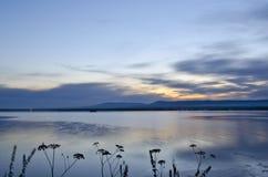 The sun rises over the Siberian lake Royalty Free Stock Photo