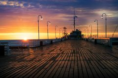 Sun rises over the Sopot Pier 2. The first rays of the sun warms the wet boards of the pier in Sopot. Poland stock images