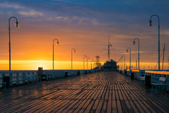 Sun rises over the Sopot Pier. The first rays of the sun warms the wet boards of the pier in Sopot. Poland stock image
