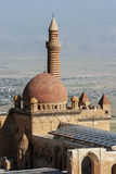 The sun rises over the spectacular dome and minaret of the Ishak Pasa Palace near the modern city of Dogubayazit in Turkey. Stock Photography