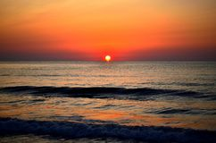 The sun rises. On Romanian beach royalty free stock photo