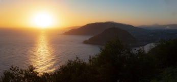 The sun rises in the sea. City of San Sebastian royalty free stock photography