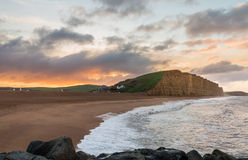 Sun rises at West Bay Dorset in UK Stock Image