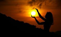 Sun Rising. Helping the Sun rise in the early morning dawn Stock Photos