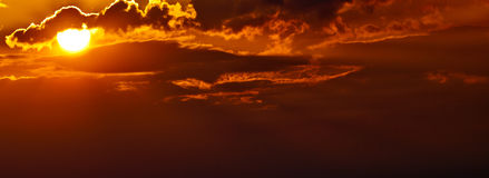 Sun Rising. The sun in the morning with behind some clouds Royalty Free Stock Photography