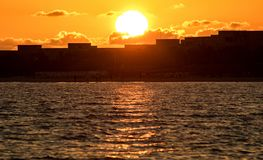Sun Rising Above The All-Inclusive Beach Resorts. The sun rises above the silhouettes of all-inclusive resorts at Cayo Coco, Cuba in the Caribbean stock image
