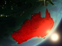 Sun rising above Australia from space. Australia from space with highly detailed surface textures and visible country borders. 3D illustration. Elements of this Royalty Free Stock Photos