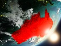 Sun rising above Australia from space. Australia from space with highly detailed surface textures and visible country borders. 3D illustration. Elements of this Royalty Free Stock Image