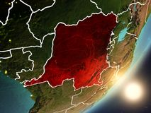 Sun rising above Democratic Republic of Congo from space. Democratic Republic of Congo from space with highly detailed surface textures and visible country Stock Images